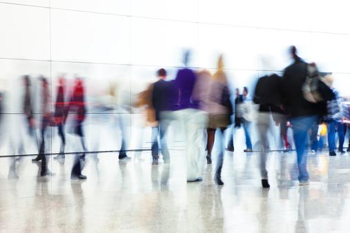 Crowd of People Walking Indoors Down Walkway, Blurred Motion