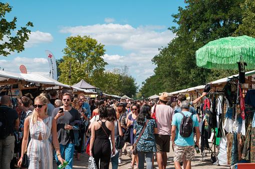 Crowd of  people walking on flea market (Mauerpark Flohmarkt) on a sunny summer day in Berlin