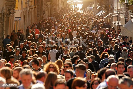 istock Crowd of people walking on street in downtown Rome, sunlight 468482500