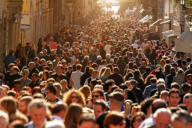 crowd of people walking on street in downtown rome, sunlight - folkmassa bildbanksfoton och bilder