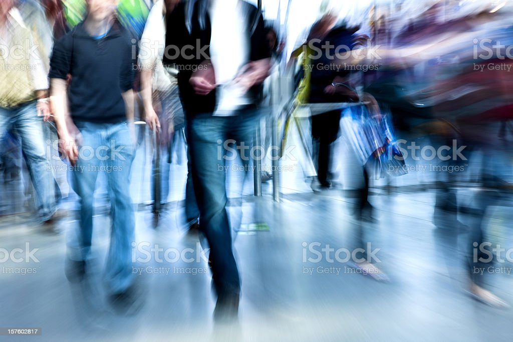 Crowd of People Walking Through Entrance Gate, Blurred Motion royalty-free stock photo