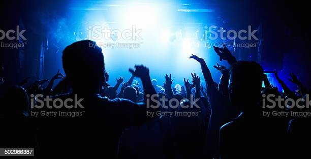 Crowd of people watching a band play on stage at a nightclub this picture id502086387?b=1&k=6&m=502086387&s=612x612&h=fyyb9cx3vu5luegjcbew2vprmwneeqdupojvb2f8las=