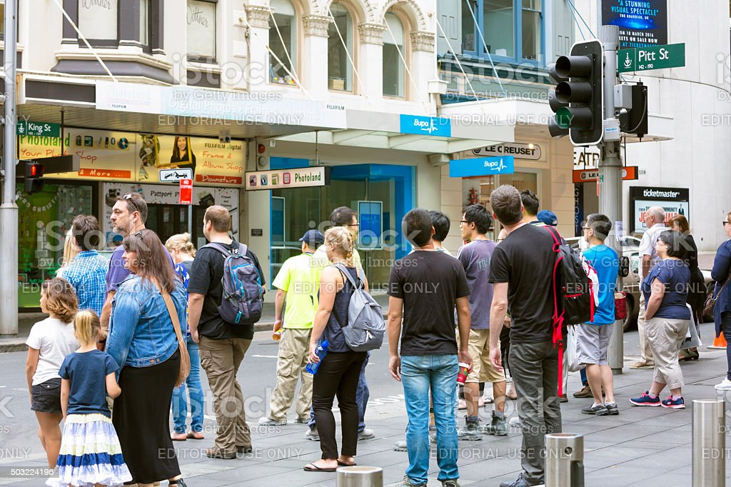 Crowd of people wating at traffic lights, Sydney Australia stock photo