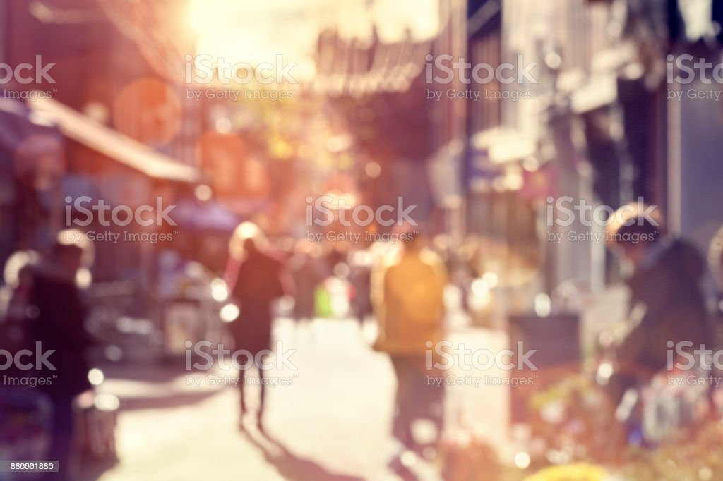 Crowd of shoppers walking and shopping on a high street stock photo