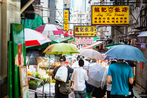 Crowd Of Shoppers Walking Through Outdoor Market Hong Kong China Stock Photo - Download Image Now