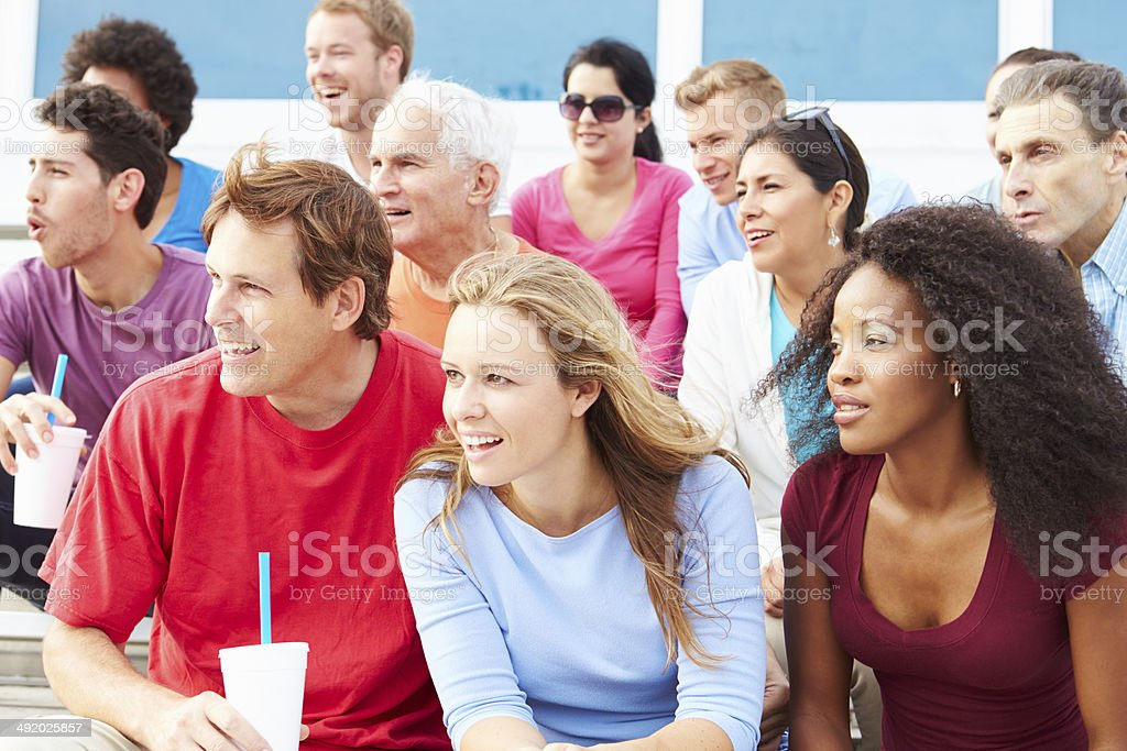 Crowd Of Spectators Watching Outdoor Sports Event stock photo