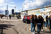 Crowd of students visiting Berlin Wall