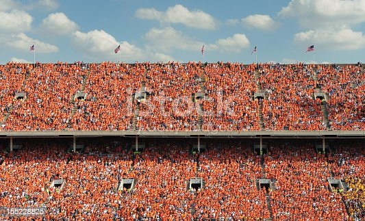 Crowd of thousands all dressed in orange