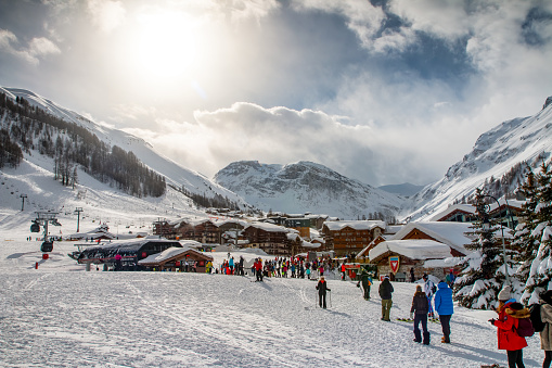 Crowd of tourists enjoying and skiing in Val d'Isere french ski resort in Alps mountains in winter