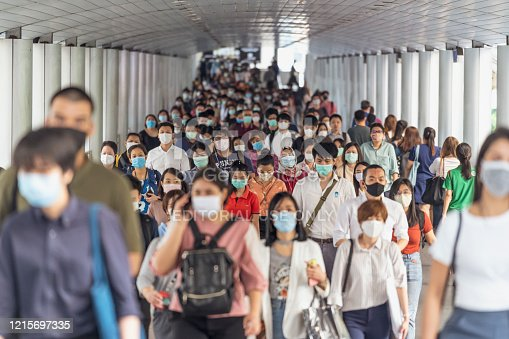 Bangkok, Thailand - Mar 2020 : Crowd of unrecognizable business people wearing surgical mask for prevent coronavirus Outbreak in rush hour working day on March 18, 2020 at Bangkok transportation