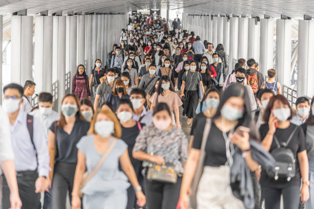 Crowd of unrecognizable business people wearing surgical mask for prevent coronavirus Outbreak