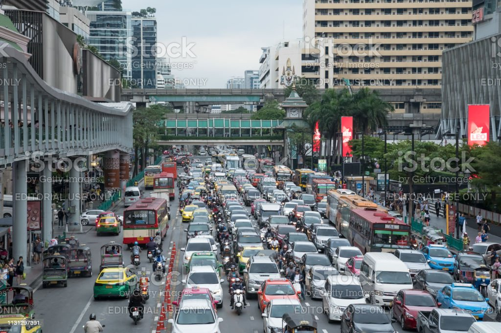 Crowd of vehicles stand in a traffic jam after work in shopping...