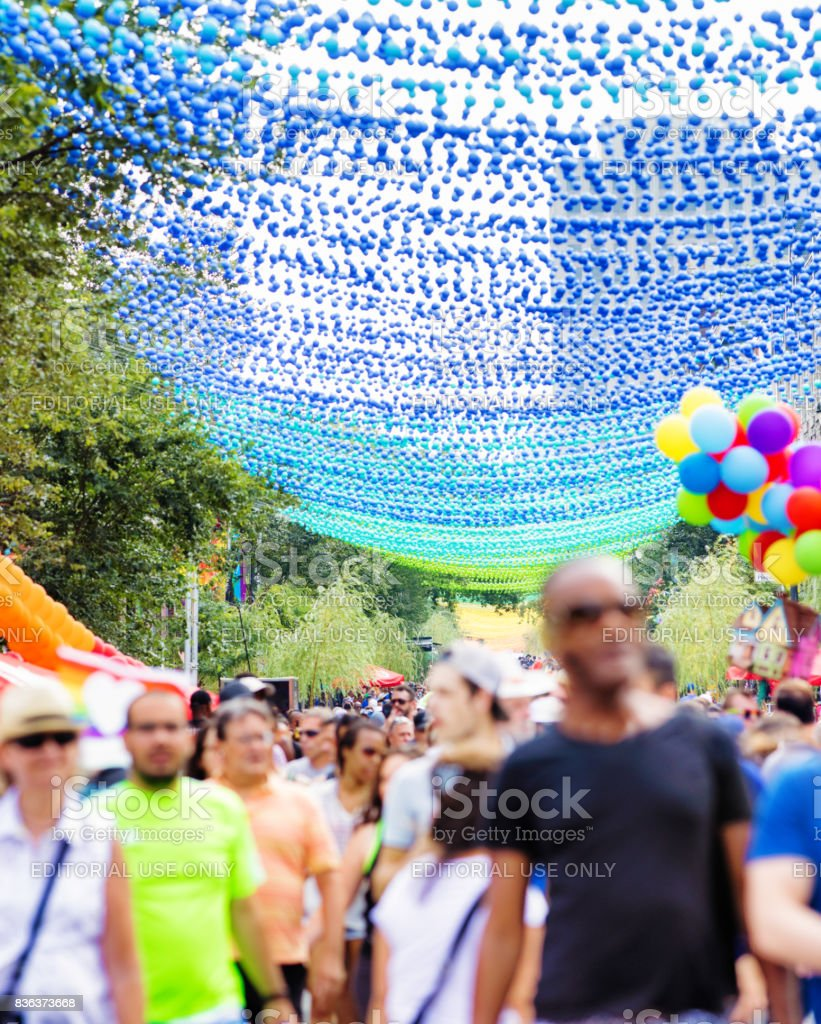 Crowd of visitors in the Montreal Gay village during gay pride stock photo