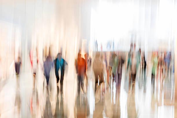 crowd of walking people - arten stock-fotos und bilder