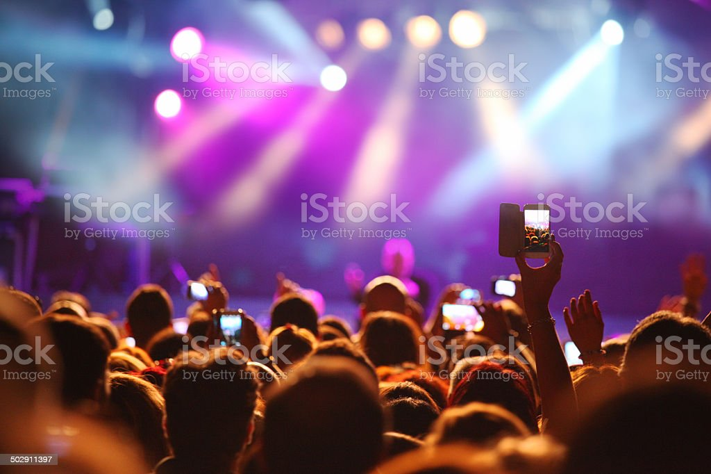 Crowd of young people at a music concert stock photo