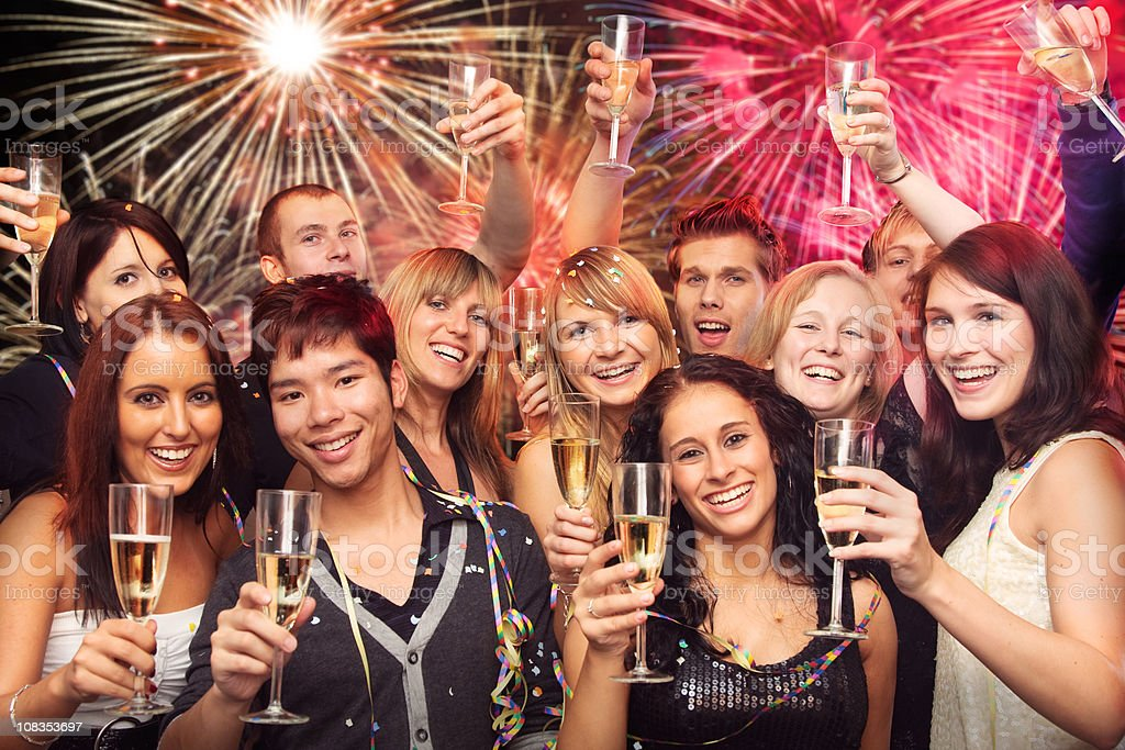 crowd of young people having a new year's party royalty-free stock photo