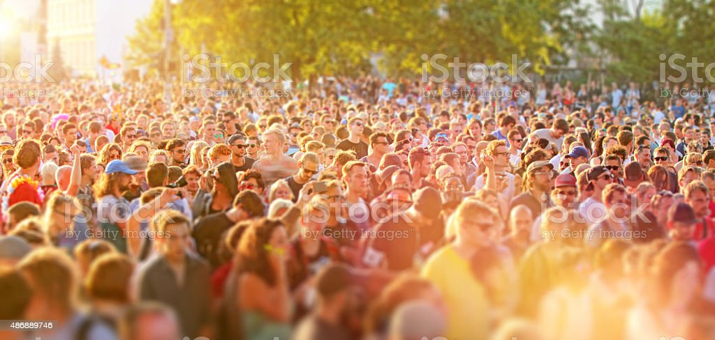 Crowd of young people having fun at music street festival stock photo