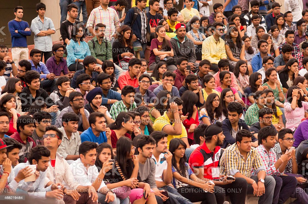 Crowd of young students watching stock photo