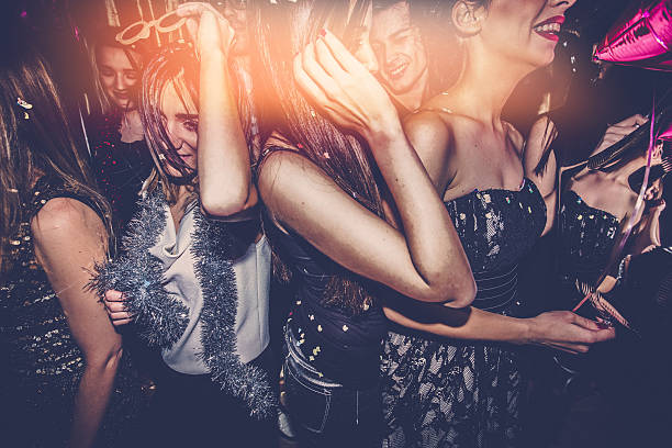 crowd on a dance floor - nightclub stock photos and pictures