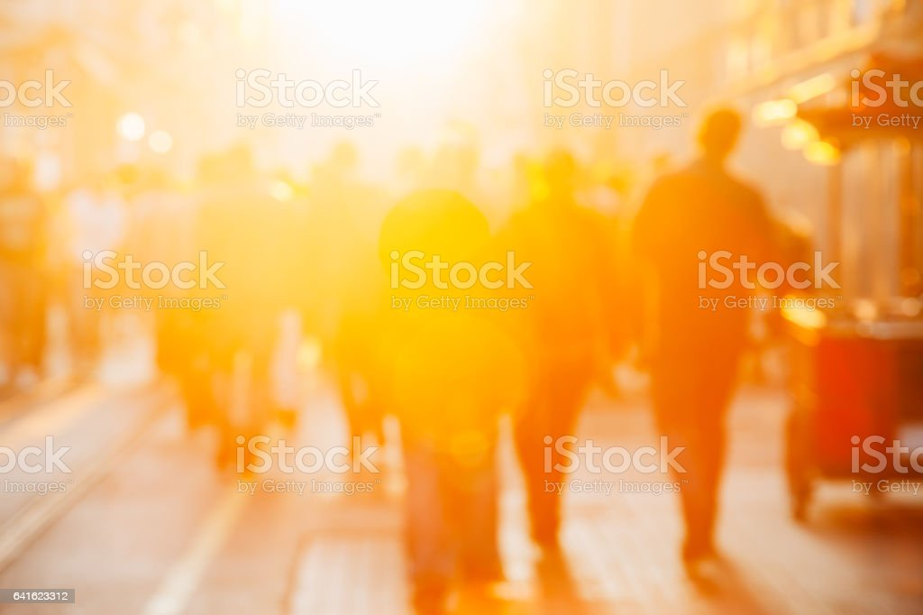Crowd on blur street in bright lens flare