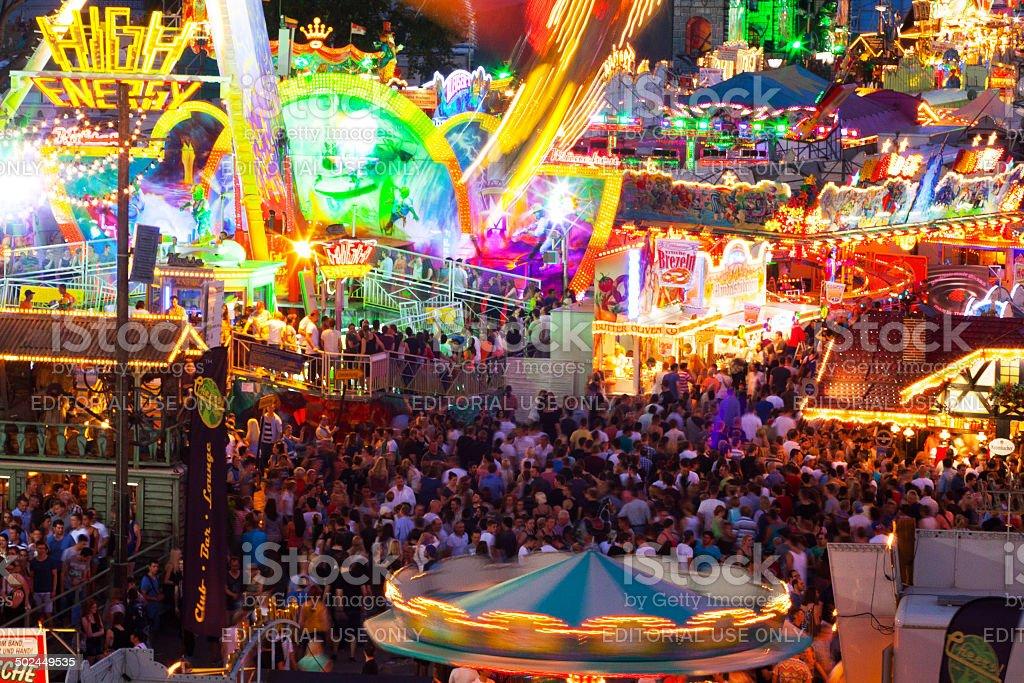 Crowd on fun fair in night stock photo