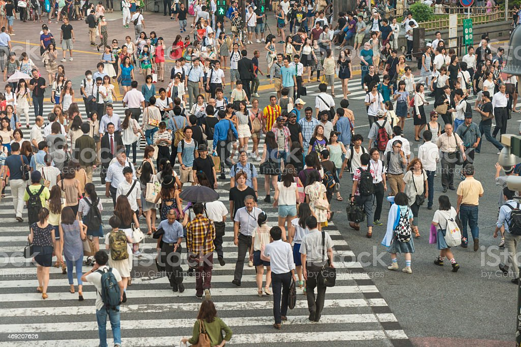 Shibuya crossing is one of the world\'s most well known examples of a...