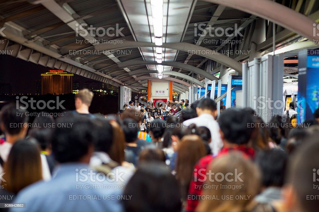 Crowd on steps of bts station Mo Chit stock photo