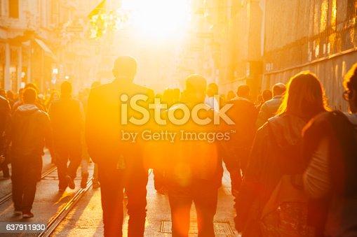 Crowded pedestrian walking on Istiklal street on sunny day with sunflare in Taksim, Beyoğlu, Istanbul, Turkey