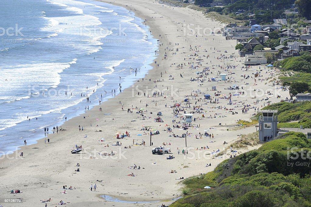 Crowd on sunny beach, California stock photo
