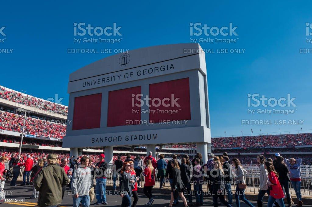 Crowd Passes Under Sanford Stadium Sign stock photo