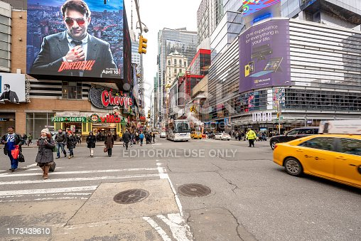 813211754 istock photo Crowd pedestrians manhattan crosswalk business tourists in New York City, USA 1173439610