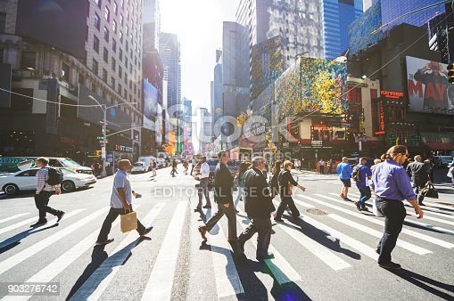 813211754 istock photo crowd pedestrians new york manhattan crosswalk business torists 903276742