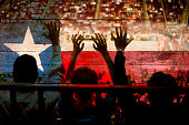 Crowd people at sports stadium. Texas flag. Basketball court. Fans.