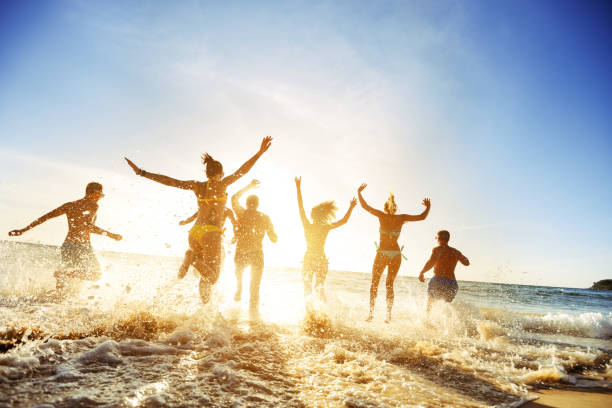 Crowd people friends sunset beach holidays stock photo