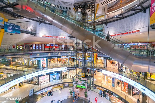 istock crowd people tourists shopping and walking in Arenas de Barcelona big oval hall interior with escalator Arenas de Barcelona is new shopping mall with Placa Espanya 1267093838