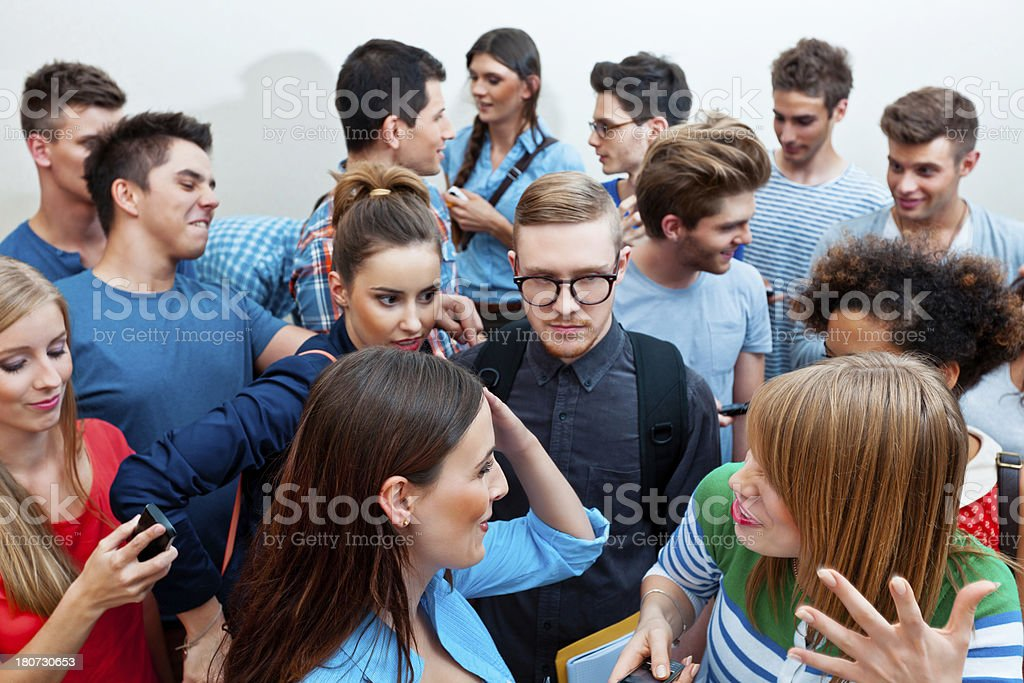 Crowd High angle view of large group of students standing together in diverse expression. 20-24 Years Stock Photo