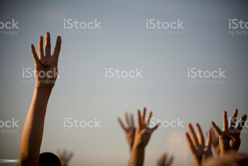Crowd raises their hands royalty-free stock photo