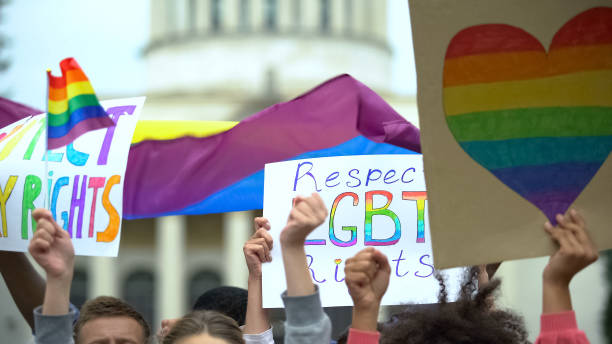 Crowd raising posters chanting to respect LGBT rights, support for gay marriage Crowd raising posters chanting to respect LGBT rights, support for gay marriage lgbtqi rights stock pictures, royalty-free photos & images