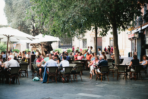Crowd seated outside restaurant in Palma, Majorca