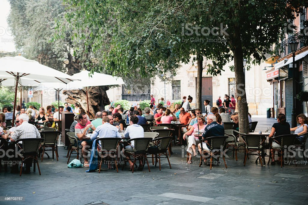 Crowd seated outside restaurant in Palma, Majorca stock photo