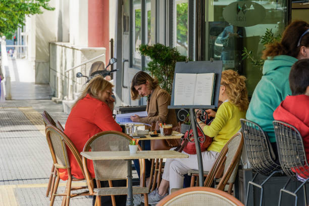 Crowd sitting on bar restaurants at the city center, after Hellenic government loosens COVID-19 coronavirus measures. stock photo