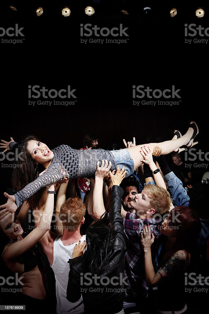 Crowd Surfing at a Rock Concert stock photo