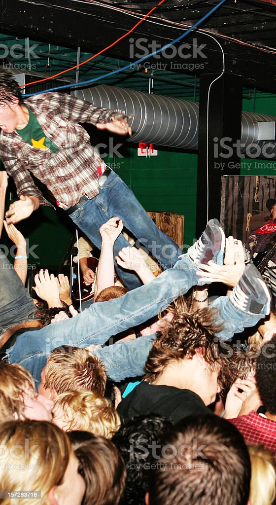 Crowd Surfing at a Rock Show royalty-free stock photo