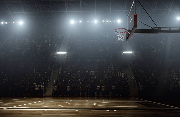 crowd waiting for basketball teams to enter the arena - basketball hoop stock pictures, royalty-free photos & images