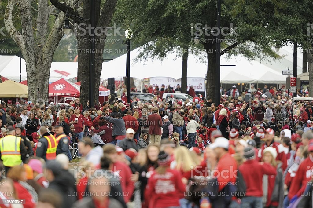 Crowd waiting for homecoming parade stock photo