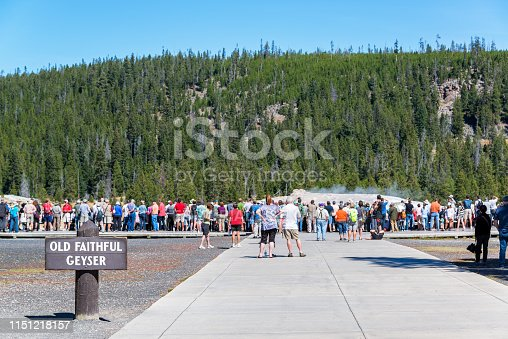 YELLOWSTONE NATIONAL PARK, WY - SEPTEMBER 11: Crowd waits for Old Faithful Geyser to erupt in Yellowstone National Park, WY on September 11, 2015