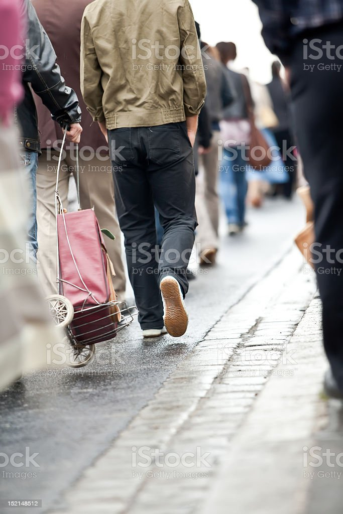 Crowd walking - group of people in motion blur royalty-free stock photo