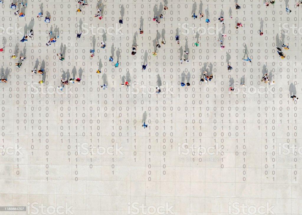 Crowd walking over binary code - Стоковые фото Асфальт роялти-фри