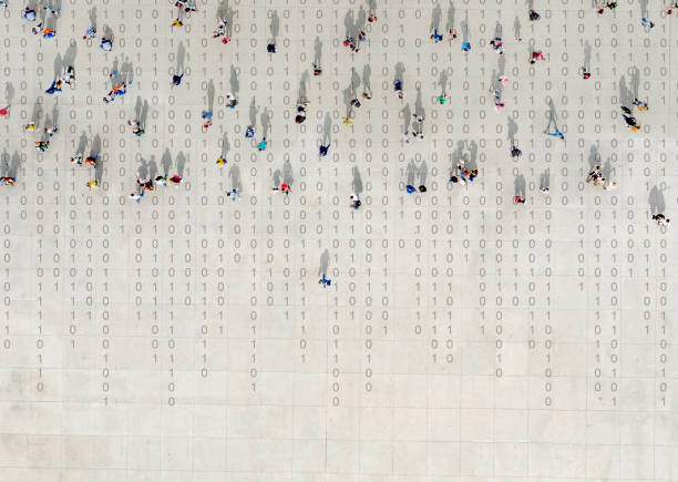 crowd walking over binary code - data stock-fotos und bilder