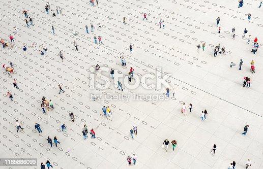 Crowd walking over binary code